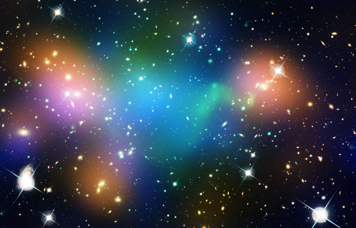 This composite image shows the distribution of dark matter (blue), galaxies, starlight from the galaxies (orange) and hot gas (green) in the core of the merging galaxy cluster Abell 520, formed from a violent collision of massive galaxy clusters. The image makes use of data from the Hubble Space Telescope, the Canada-France-Hawaii Telescope in Hawaii, and the NASA's Chandra X-ray Observatory.