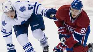 Toronto Maple Leafs' Jake Gardiner (51) and Montreal Canadiens' Lars Eller (81) battle during third period NHL hockey action in Montreal, Saturday, April 7, 2012. THE CANADIAN PRESS/Graham Hughes