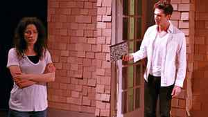 "Joanne Kelly and Joe Dinicol in a scene from ""Proof"""