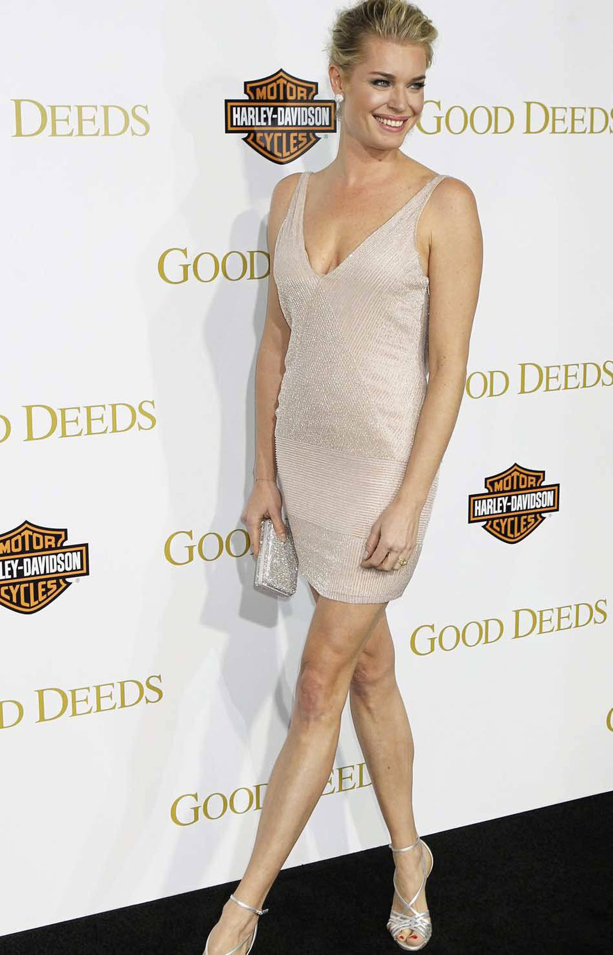 "Rebecca Romijn is one deep breath past a wardrobe malfunction at the premiere of ""Good Deeds"" in Los Angeles last week."