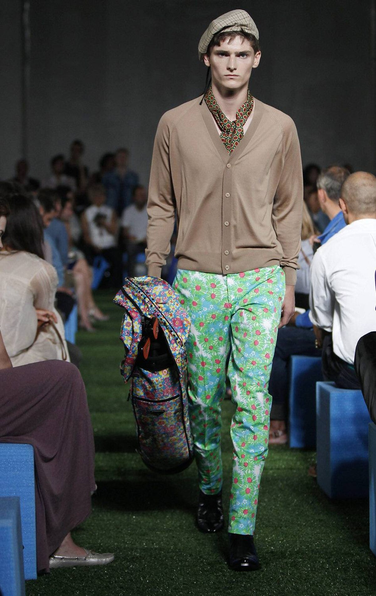 A model wears part of the Prada men's spring-summer 2012 collection in Milan, Italy, on Sunday, June 19, 2011.