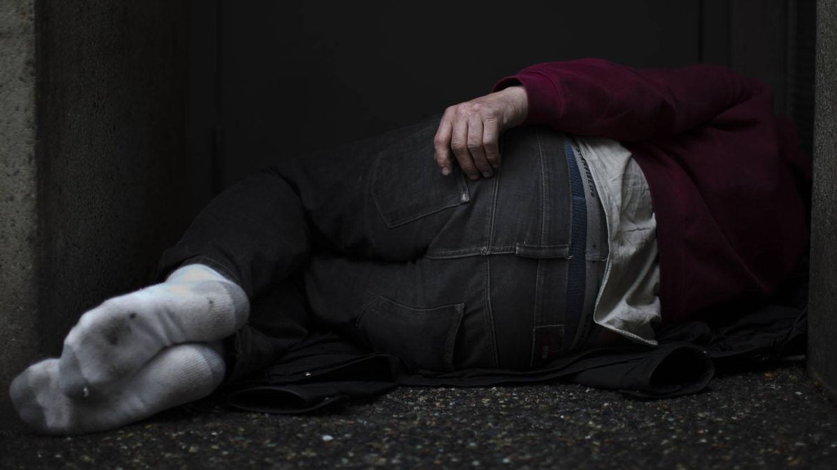 A homeless man sleeps in a doorway in downtown Vancouver, British Columbia, Thursday, January 27, 2011.