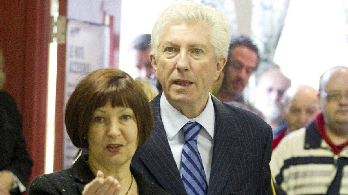 Bloc Quebecois Leader Gilles Duceppe and his wife Yolande Brunelle walk in a polling station to vote Monday, May 2, 2011, in Montreal, Que.