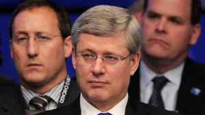 Prime Minister Stephen Harper, middle, sits in front of Minister of Defence Peter MacKay, left, and Minster of Foreign Affairs John Baird as they take part in a meeting on Afghanistan during the NATO Summit in Chicago, Ill., on Monday, May 21, 2012.