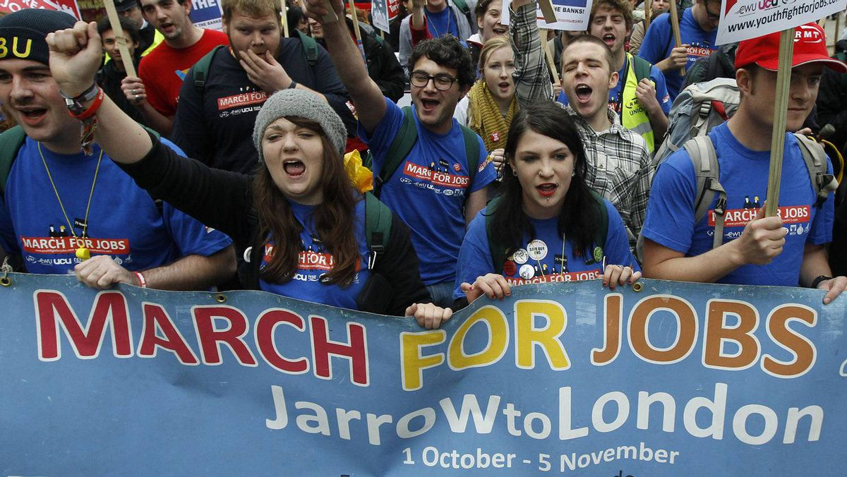 Demonstrators protest against job cuts in central London November 5, 2011. Many of the demonstrators had marched from Jarrow in north east England, recreating a 1936 protest march against unemployment.