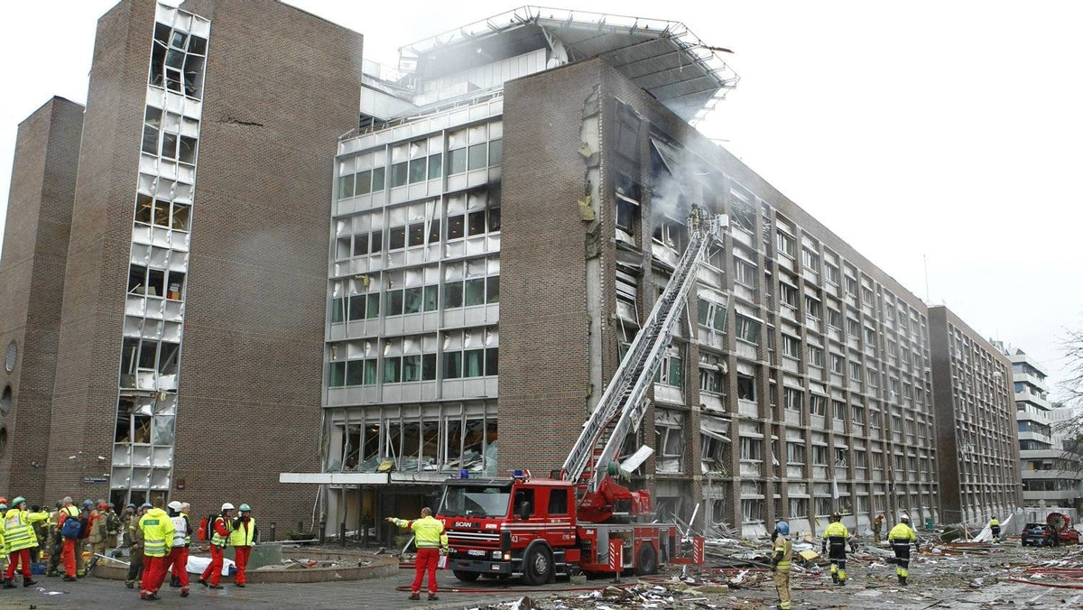 Firefighters work at the site of an explosion near government buildings in Norway's capital Oslo on July 22, 2011.