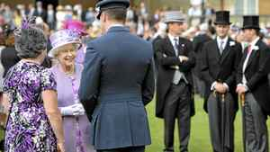 Britain's Queen Elizabeth greets guests at a garden party at Buckingham Palace, in central London, May 29, 2012.