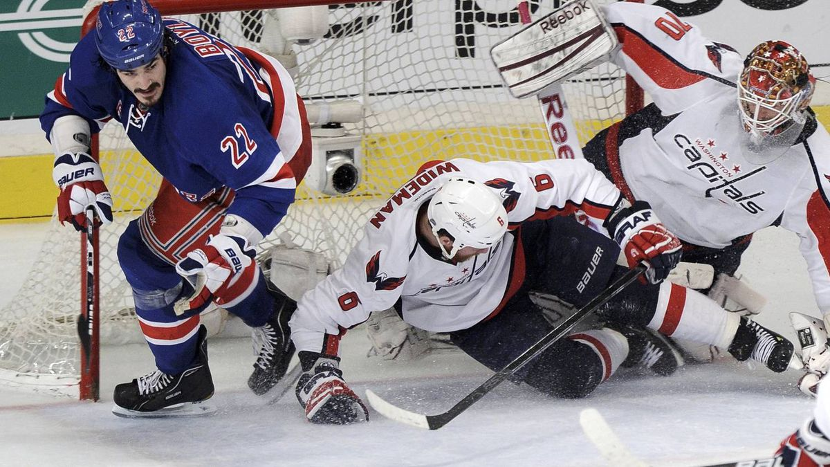 Washington Capitals' Dennis Wideman (C) slides into the net with goalie Braden Holtby (R) as New York Rangers' Brian Boyle (L) skates from the crease during the third period in Game 7 of their NHL Eastern Conference semi-final playoff hockey game at Madison Square Garden in New York, May 12, 2012. The play was ruled a dis-allowed goal. REUTERS/Ray Stubblebine