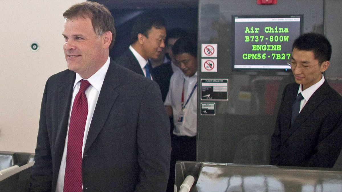 Foreign Minister John Baird walks out of a Boeing 737-800 flight simulator at Air China's training center in Beijing on July 19, 2011.