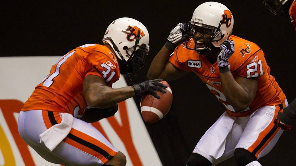 B.C. Lions' Dante Marsh and Ryan Phillips celebrate Marsh's interception against the Montreal Alouettes during the second half of a CFL football game in Vancouver, B.C., on Saturday.