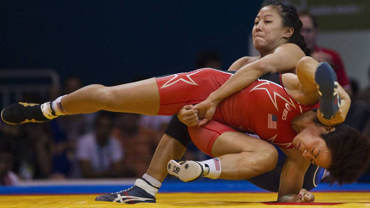 Canada's Carol Huynh upends Clarissa Chun of the U.S. during the gold medal match for women's 48kg wrestling at the Pan American Games in Guadalajara October 22, 2011. Huynh won the bout. The Games run through October 30. REUTERS/Andy Clark
