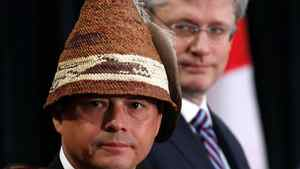 Assembly of First Nations Chief Shawn Atleo (L) and Canada's Prime Minister Stephen Harper take part in the opening ceremony at the Crown-First Nations Gathering in Ottawa January 24, 2012.