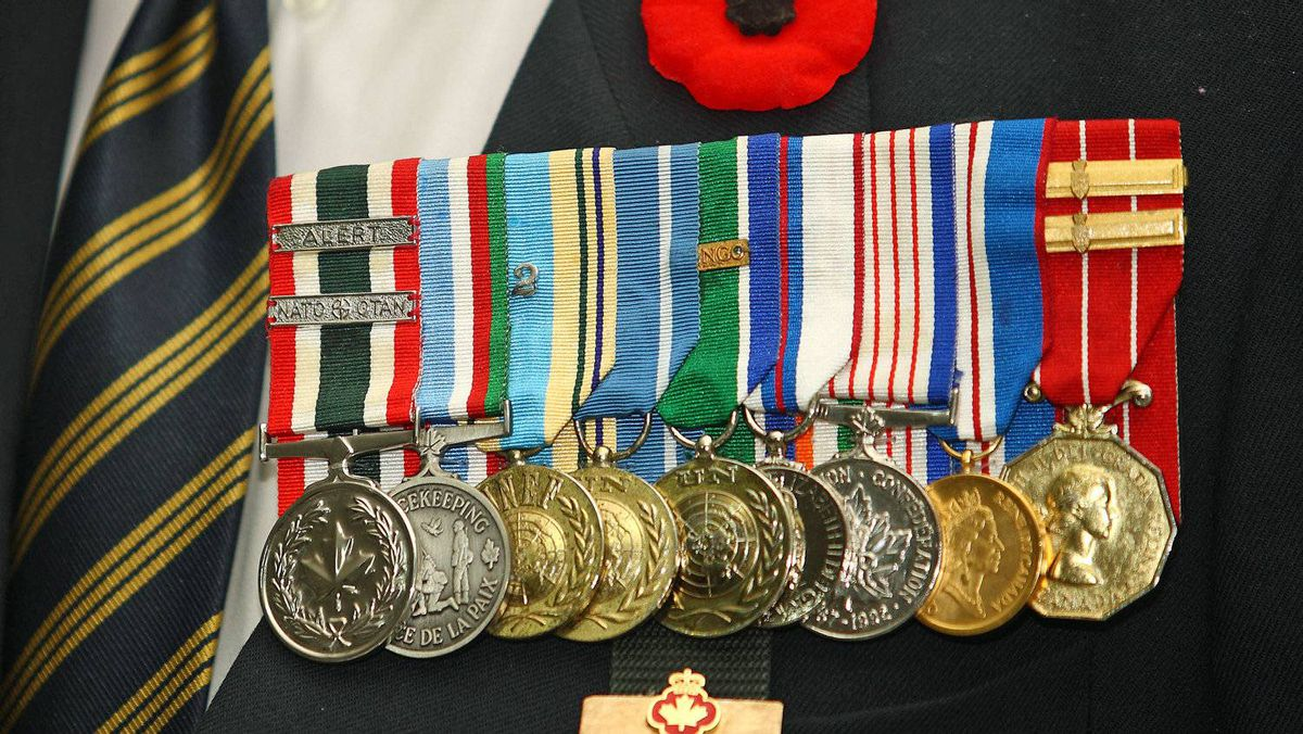 A Canadian veteran wears his medals ahead of 2010 Remembrance Day ceremonies in New Victoria, N.S.