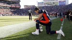 Denver Broncos quarterback Tim Tebow prays near the endzone prior to their NFL football game against the Chicago Bears in Denver December 11, 2011.