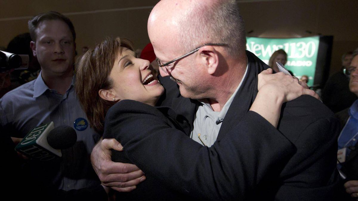 Premier-designate Christy Clark is congratulated by MLA Pat Bell at the BC Liberal Convention in Vancouver after she won the Liberal leadership on Feb. 26, 2011.