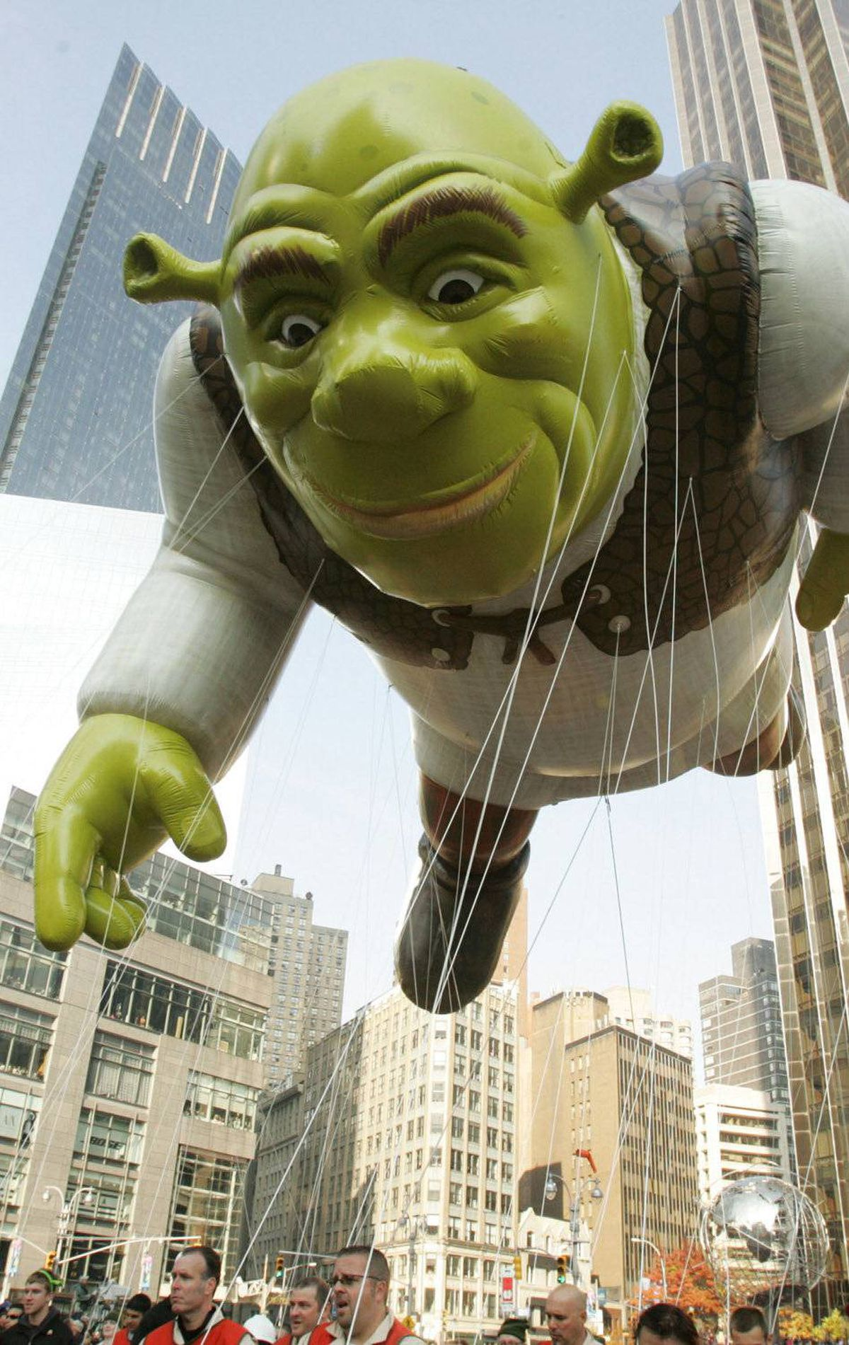A Shrek balloon floats in New York, no doubt giving nightmares to young children below it.