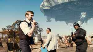 Sharlto Copley, Mandla Gaduka and Kenneth Nkosi are shown in a scene from the sci-fi thriller DISTRICT 9.