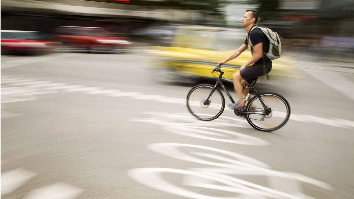 A cyclist makes his way along the bike lane at the corner of Hornby Street and Robson Street in Vancouver on June 27, 2011.