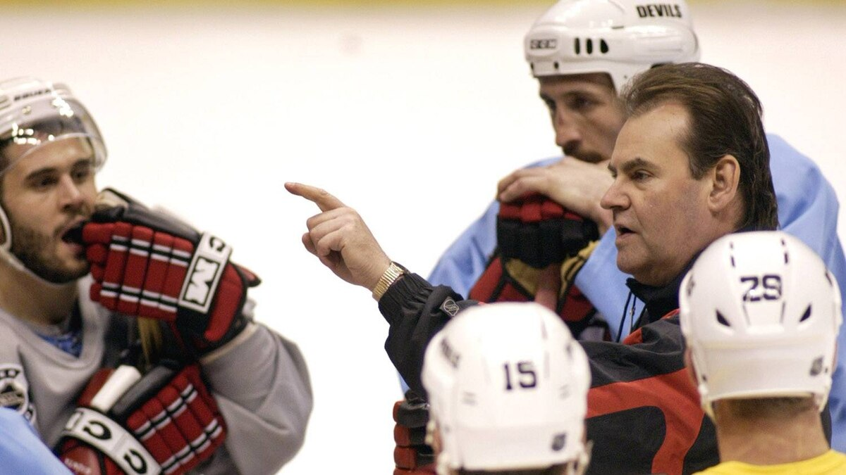 New Jersey Devils coach Pat Burns makes a point during their practice session in East Rutherford, New Jersey, June 4, 2003, as they get ready for Game 5 of the NHL Stanley Cup Finals against the Anaheim Mighty Ducks. Around him are Brian Gionta (L), Jamie Langenbrunner (15), Grant Marshall (29) and Pascal Rheaume. The series is tied at two games each. REUTERS/Ray Stubblebine