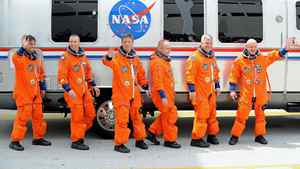 Endeavour's crew members leave their quarters at the Kennedy Space Center in Florida, April 29, 2011, shortly before the shuttle's launch was scrubbed.