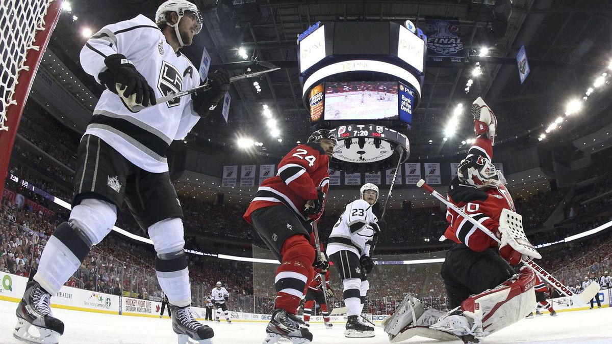 Los Angeles Kings' Anze Kopitar (L) watches as New Jersey Devils goalie Martin Brodeur (R) makes a save as Devils' Bryce Salvador (24) and the Kings' Dustin Brown follow the play during the second period in Game 1 of the Stanley Cup final in Newark, New Jersey, May 30, 2012.