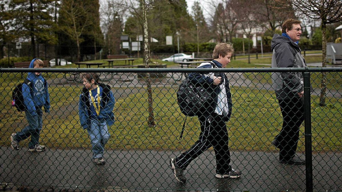 Eric Jamieson arrives MOnday with his three sons at the Shaughnessy Point Grey Out of School Care Society located at Quilchena Elementary school in Vancouver.