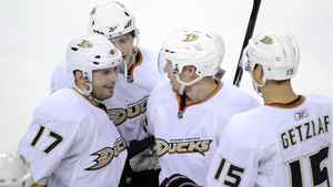 Anaheim Ducks' Lubomir Visnovsky, left, from Slovakia, celebrates his goal against the Calgary Flames with teammates Corey Perry, left to right, Toni Lydman and Ryan Getzlaf during second period NHL hockey action in Calgary, Alta., Wednesday March 30, 2011.