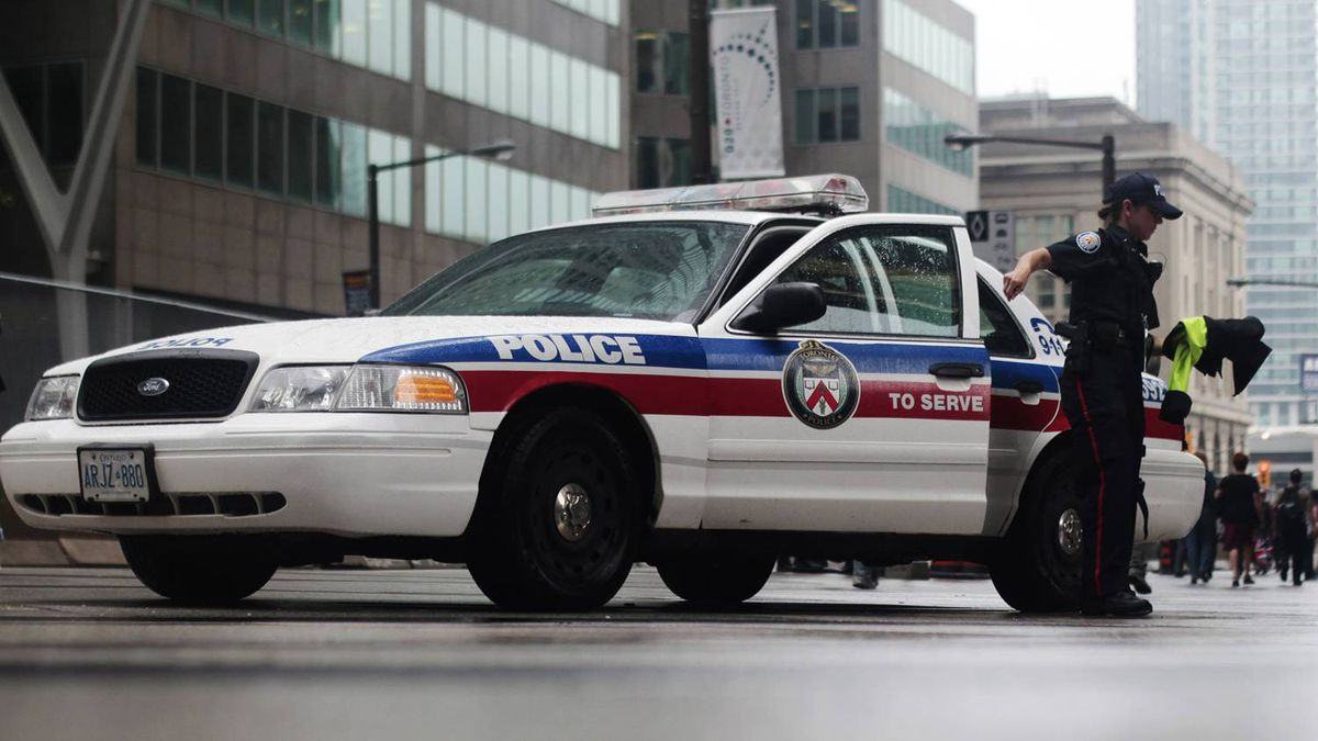 A police officer gets out her car on the sidewalk ahead of the G20 summit in Toronto, June 22, 2010.