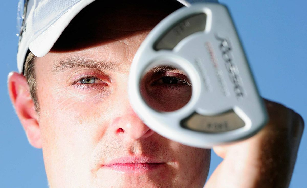 Justin Rose poses with the TaylorMade 'Ghost' putter that he won two out the last three PGA Tour events