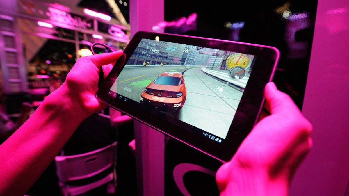 An exhibitor plays a video on the T-Mobile LG G-Slate tablet at the T-Mobile booth during the Electronic Entertainment Expo on June 7, 2011 in Los Angeles.