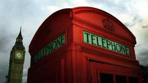A British Telecommunications (BT) phone box in Parliament Square, London. BT is selling 60 of the famous phone kiosks with a starting price of $3,100.