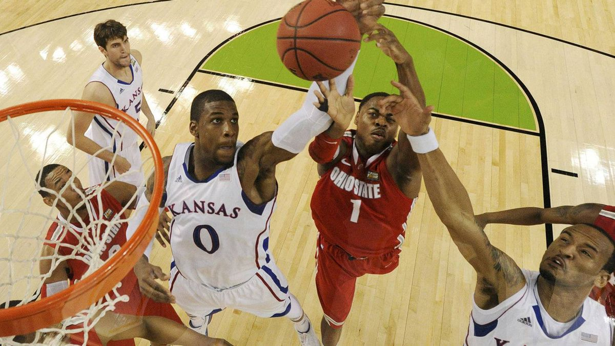 Kansas Jayhawks forward Thomas Robinson (0) rebounds with Ohio State Buckeyes forward Deshaun Thomas (1) and Jayhawks guard Travis Releford (R) during the first half of their NCAA Final Four semifinal college basketball tournament game in New Orleans, Louisiana, March 31, 2012. REUTERS/Chris Steppig-NCAA Photos/POOL