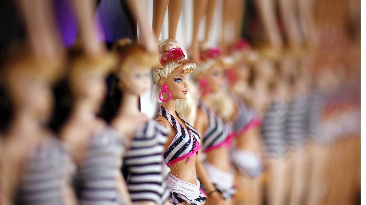 Barbie dolls are lined up on the wall at a 50th birthday party at Barbie's real-life Malibu Dream House in Malibu, California March 9, 2009.
