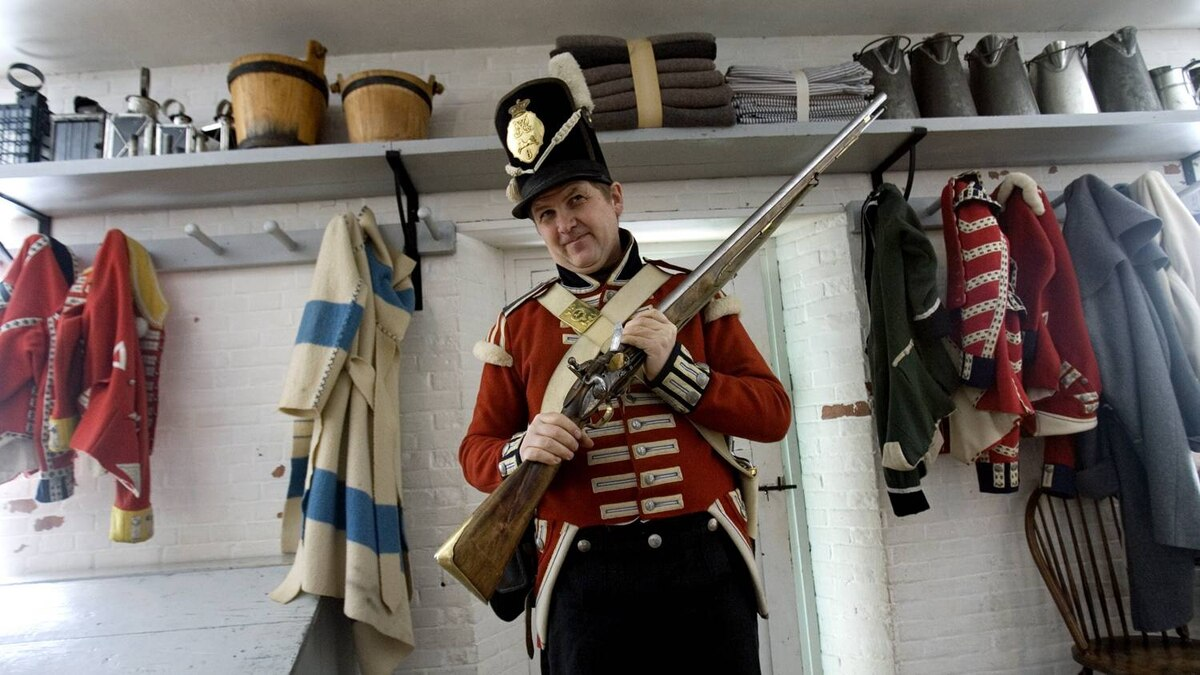 A program officer at Fort York leads a tour the Toronto historic site, which was key outpost in the War of 1812.