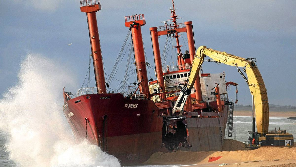 The beached TK Bremen cargo ship is broken apart at Erdeven, near Lorient, western France, Saturday, Jan. 7, 2012. High winds beached the cargo ship off France's Atlantic coast last month.