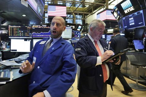 United States stocks close higher as banks climb