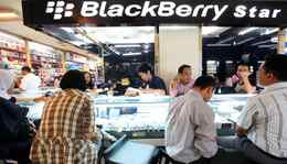 People buy BlackBerry phones at a shop in ITC Ambassador shopping mall in Jakarta.