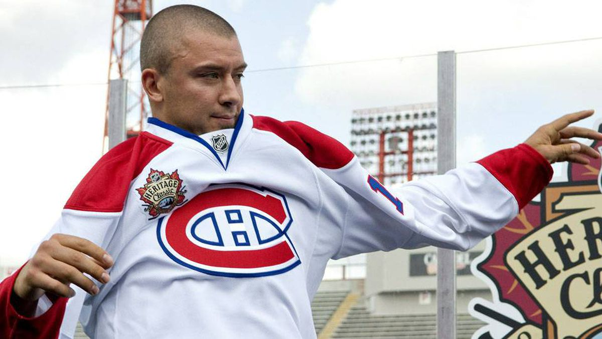 Josh Gorges of the Montreal Canadiens puts on his jersey at the NHL Heritage Classic Press Conference at McMahon Stadium on August 4, 2010 in Calgary, Alberta, Canada. (Photo by Dylan Lynch/Getty Images)
