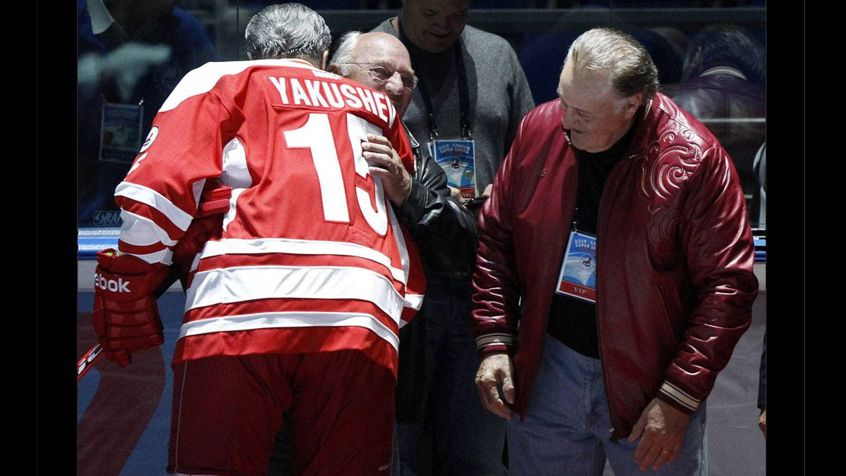 Canadian former hockey players Phil Esposito, right, and Dennis Hull, centre, greet former rival Russian hockey player Alexander Yakushev during the starting ceremony for an exhibition game in Moscow on Feb. 25, 2012 between teams of Russian and world stars to mark the anniversary of U.S.S.R.-Canada 1972 Summit Series.
