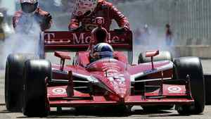 Franchitti gets pushed out of his pit stop by his crew during the Edmonton Indy in Edmonton