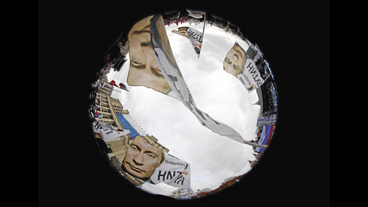 Supporters of Russian Prime Minister Vladimir Putin are seen through a fisheye lense before a rally in central Moscow on March 5, 2012.
