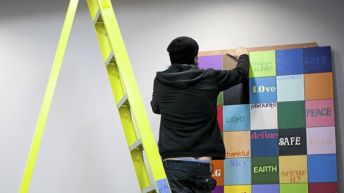 "Rennie Collection art installers Angus Ferguson(left) and Beau Kerner(right) mount the ""What Colour are You?"" in the dining room at Union Gospel Mission in Vancouver, Wednesday, April 11, 2012."
