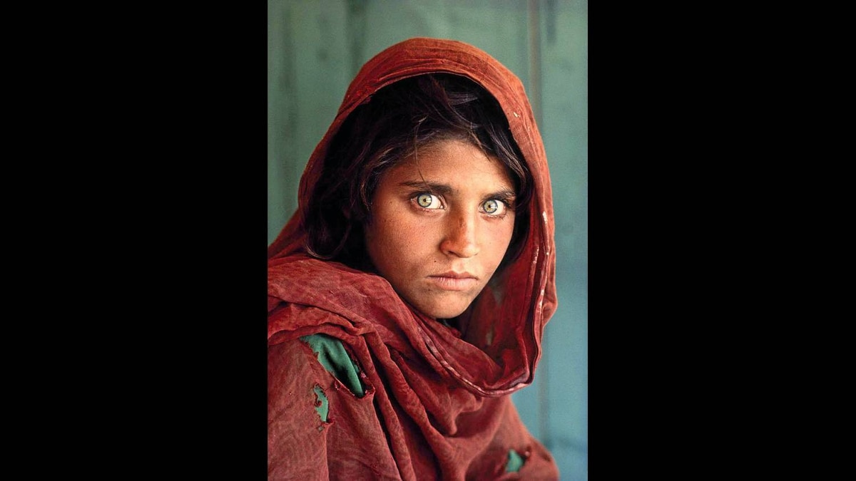 Afghan Girl, shot in Peshawar, Pakistan, in 1984. This photo was used for an iconic cover of National Geographic magazine.