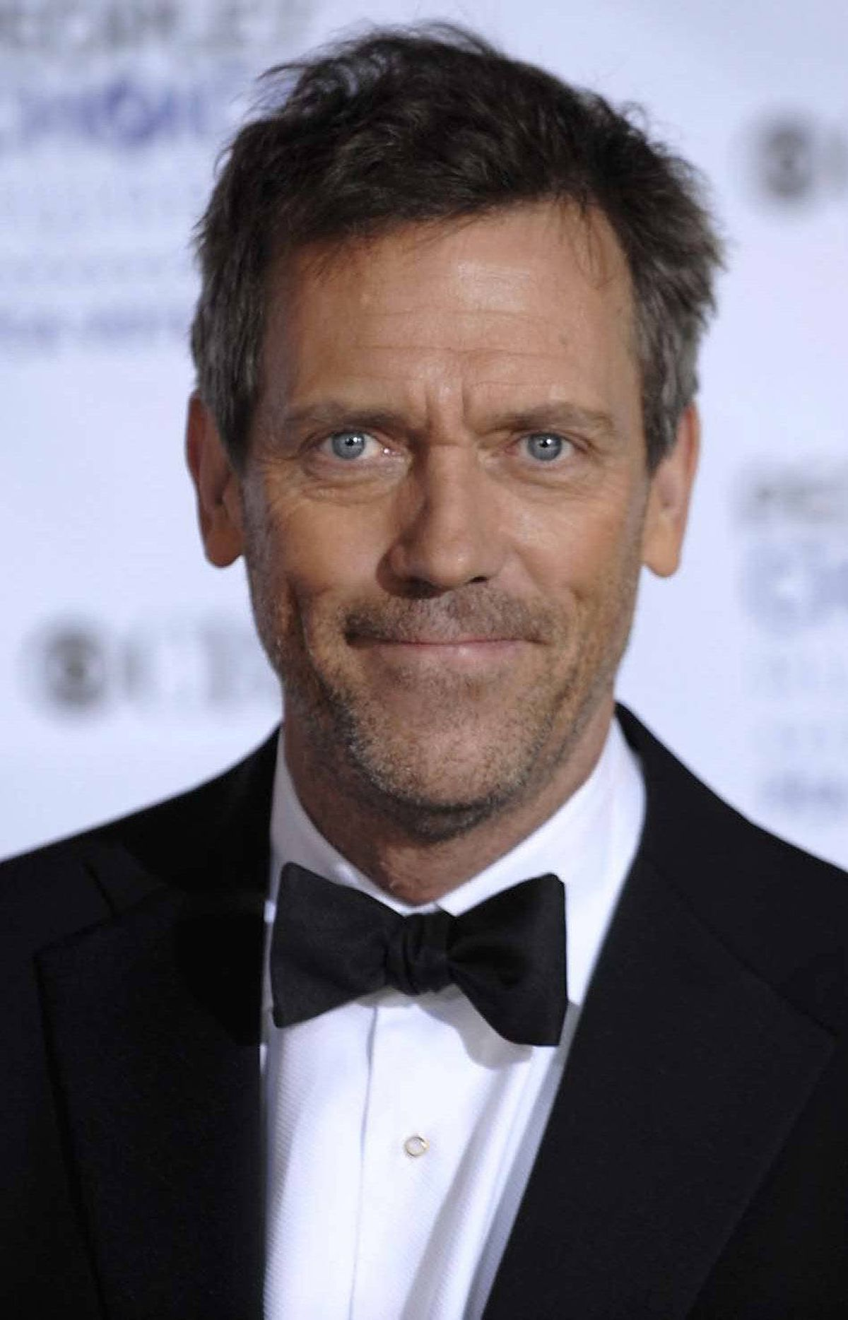 "TV star Hugh Laurie has a juicy role in ""The Oranges."""