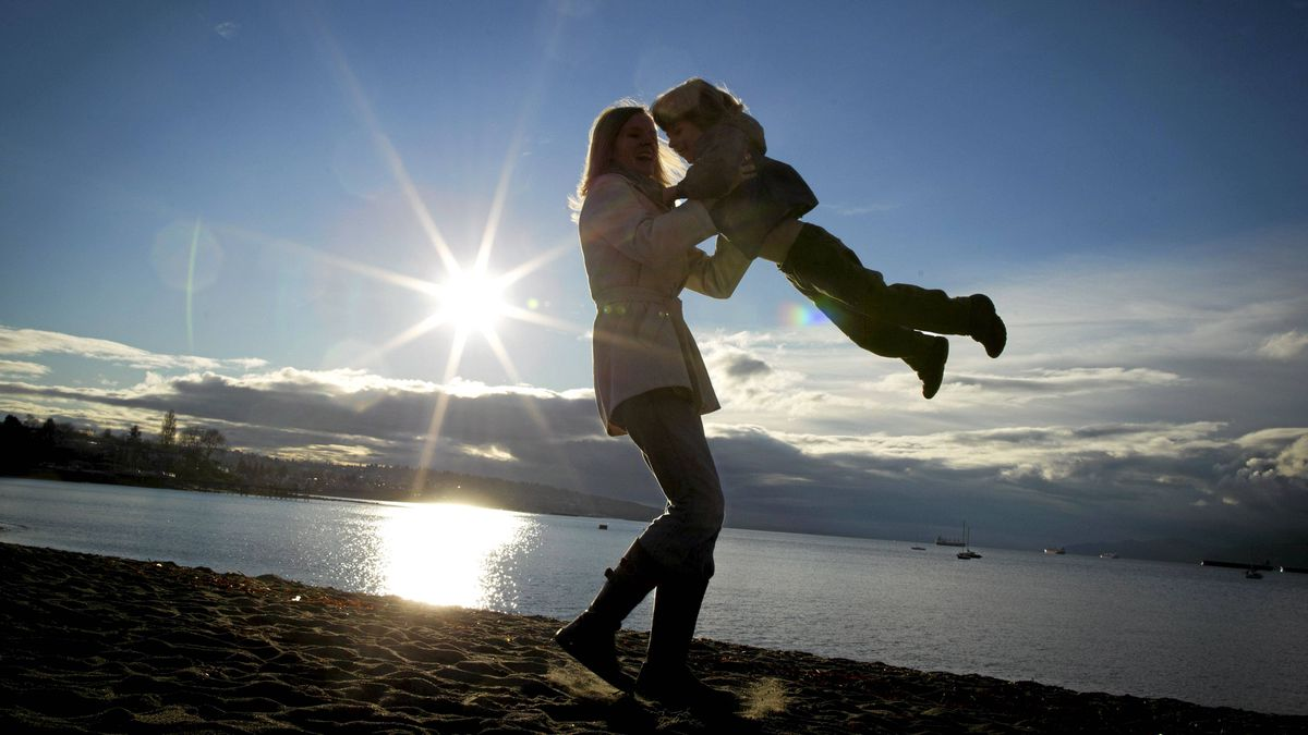 Heather Beach swings her four-year-old son, Silas, through the air near their home in Vancouver March 25, 2011. Silas has Prader-Willi syndrome which is a congenital disease that involves obesity, decreased muscle tone, decreased mental capacity, and sex glands that produce little or no hormones.