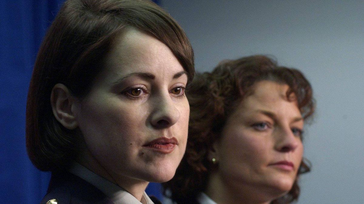 RCMP Constable Catherine Galliford, left, and Vancouver police Detective Constable Sheila Sullivan attend a news conference in Vancouver on Jan. 27, 2004.