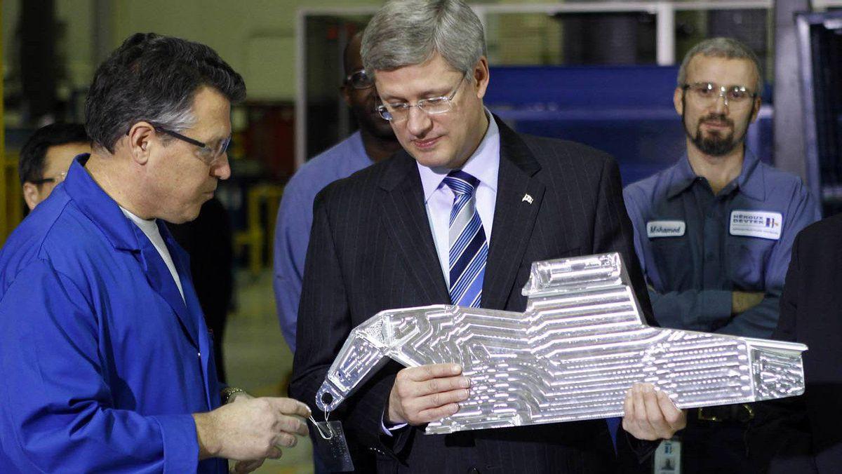 Prime Minister Stephen Harper visits a Heroux-Devtek in Montreal on Jan. 14, 2011.