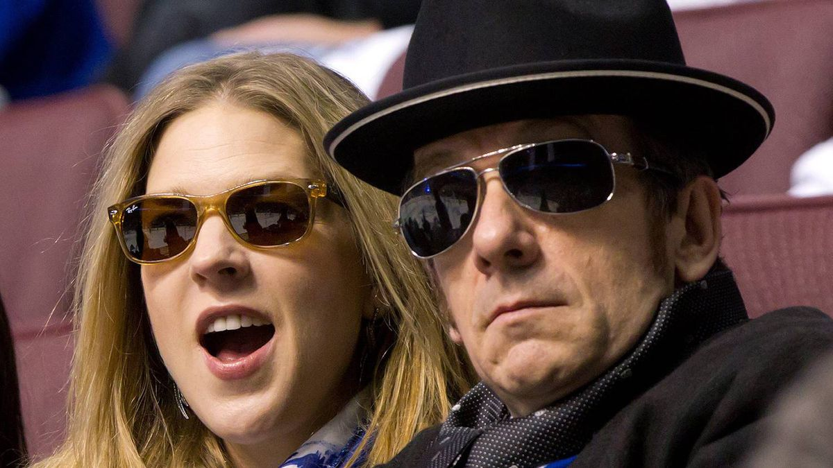 Canadian singer Diana Krall, left, cheers as she and her husband, singer Elvis Costello watch the Vancouver Canucks play the Nashville Predators during game 2 of an NHL Western Conference semi-final Stanley Cup playoff hockey series in Vancouver, B.C., on Saturday April 30, 2011. Costello performed his hit song Pump It Up with local Vancouver band Odds in the moments before the opening faceoff. THE CANADIAN PRESS/Darryl Dyck