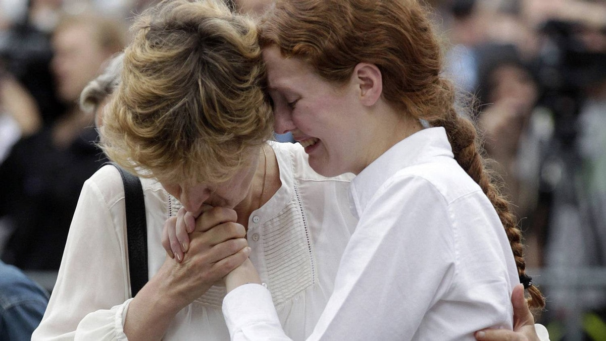 Survivors of a shooting rampage on the Utoeya island break out in tears following a memorial service in the Oslo, Norway cathedral July 24, 2011.