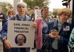 Some of the victims of financial advisor Earl Jones call for harsher sentences for white collar crimes during a demonstration in front of the courthouse in Montreal, Quebec. Jones is charged with defrauding his clients of over $50 million.